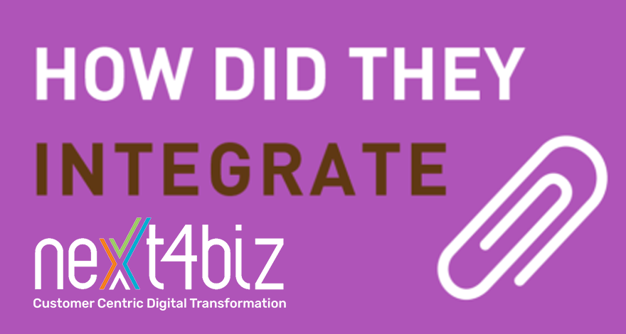 Which systems became integrated into next4biz?